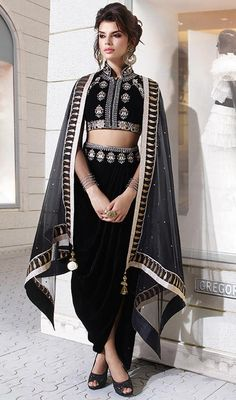 Get lionized by the fashion society by dressing into this black color velvet embroidered dhoti style suit. The resham and stones work appears chic and excellent for any function. #SexyBlackVelvetDhotiStyleDress