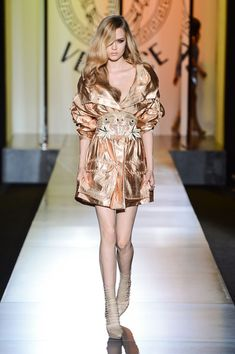 Versace Couture Fall 2012 Could be worn as a jacket or just it's own outfit.. The fabric is too luxurious to be worn as outerwear but still falls in the fall category