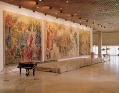 The three Chagall tapestries lining the wall of the Chagall State Hall.