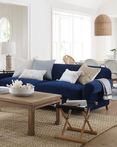 homedecor living room Casual living room inspiration: We love the balance of dark and light tones in this relaxing living room. A wooden coffee table, natural fiber rug, and wooden decor add a natural feel while balancing the navy blue of the sofa. Blue Couch Living Room, Blue Living Room Decor, Coastal Living Rooms, Living Room Color Schemes, Living Room Designs, Colour Schemes, Navy Blue And Grey Living Room, Coastal Cottage, Living Room Ideas Navy Sofa