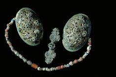 Glass Beads, VikingAge. The glass beads hung between two tortoise brooches. Grave find, Björkö, Adelsö, Uppland, Sweden. SHM 34000:Bj 1081