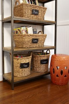Baskets and chalk tags for toy organization. #storage #organization #toys #forthehome