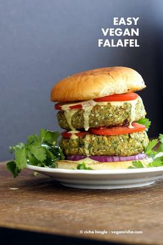 Easy Vegan Falafel Burger. Chickpea patties with 5 minute tahini dressing, tomatoes, onions, dill pickles. Vegan Soy-free Recipe. Can be made gluten-free