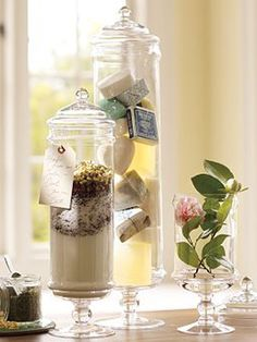 Instead of postcards, etc: keep some sand and shells from a beach as souvenirs and set it up in an apothecary jar. OR collect hotel sample soaps, etc and do the same thing.
