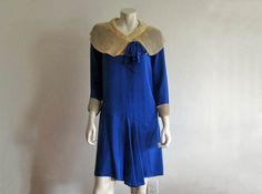 Charming 1920s asymmetrical, peacock blue day dress. This long sleeve dress is constructed of silk and organza. Classic flapper…