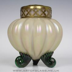 Bohemian antique Art Nouveau period white cased glass rose bowl with applied green feet Has an all over iridescence around the outside Measures 15cm