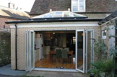 Hardwood kitchen extension Project by Heritage Conservatories. House Extension Design, Extension Designs, Extension Ideas, Concertina Doors, Kitchen Family Rooms, House Extensions, Conservatory, My Dream Home, Hardwood