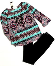 This tribal print top is perfect for any occasion! Pair it with booties for a date night outfit!