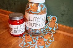 "Barrel of Monkeys - PreMade monkeys, high frequency words, some with no words and bananas on them... kids take turns taking a monkey out and reading the word, when they get a monkey with a banana, they say ""bananas"" and put all of their monkeys back in the barrel."