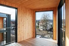 Image 3 of 20 from gallery of Hagmannareal Housing Development / ARGE HAGMANNAREAL + weberbrunner architekten ag + Soppelsa Architekten. Wood Facade, Wood Architecture, Winterthur, Garage Doors, Gallery, Outdoor Decor, Projects, House, Home Decor
