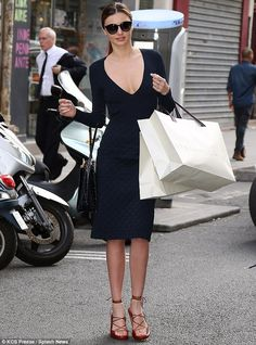 Serious style: Miranda Kerr looked lovely in navy as she hit the shops on Sunday in Paris