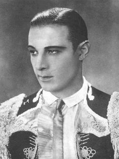 "Adored by female movie-goers, Italian-born actor Rudolph Valentino was known simply as ""Valentino."" The charismatic actor starred as the handsome, mysterious lover in silent pictures such as ""The Sheik"" and ""Blood and Sand."" His sudden death at 31 in 1926 caused hysteria and riots among his female fans! Born in Castellaneta, Valentino came here through Ellis Island in 1913"
