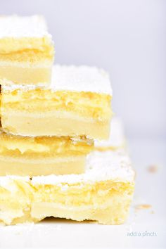 This easy Lemon Bars Recipe makes a delicious sweet treat! Layered onto a shortbread crust, this tart, yet sweet lemon bar is perfect for the lemon lover!