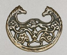 8th-9th century, Tibet, 'togchag' (amulet) representing horse, was used as a buckle, at the Ashmolean Museum (UK)