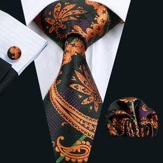 "3pc Silk Necktie Set Color: Black,Dark Orange and Purple 59"" Length, 3.4"" Width Matching cufflinks and pocket square"