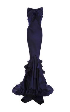 This **Zac Posen** gown features a mermaid silhouette and a ruffled hem.