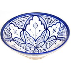 This handcrafted Moroccan bowl was free-hand painted in Fez and decorated with pleasing and distinctive white and blue colors, ready to be displayed on your wall, shelf or wherever you desire a pop of color and stylish accent.