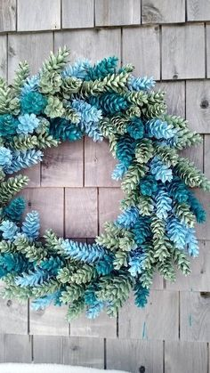 Could also do this in red and green for Christmas.Large Pinecone Wreath In Blue and Greens by scarletsmile on Etsy Pine Cone Art, Pine Cone Crafts, Wreath Crafts, Diy Wreath, Pine Cones, Diy Crafts, Wreath Ideas, Felt Crafts, Pine Cone Wreath