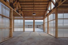 Located in the farmland on the fringe area of Guye district in Tangshan, China, Arch Studio designed a wood and policarbonate building that acts as a processing workshop of organic food.