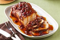 Come home to this Slow-Cooker Cranberry-Orange Pork Roast. Cranberry sauce and orange work their magic in this Slow-Cooker Cranberry-Orange Pork Roast.