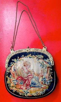 Vintage Needlepoint Purse with Intricate Gold-toned Metal Frame and Attached Change Purse. $75