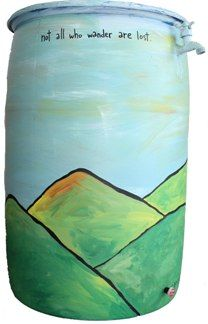 """""""Cap Man"""" Jimmy Straehla created a rain barrel to catch rainwater running from any mountain top.  2013"""