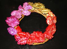 a christmas mini wreath in purple, red and gold chosen by the recipient to match their room decor. Made from UTEE jewel enamel