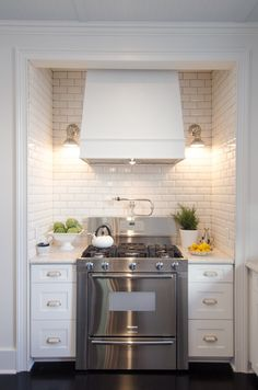 Traditional Kitchen with Complex granite counters, flush light, Subway Tile, full backsplash, Wall sconce, double oven range