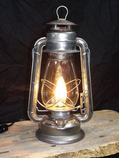Rustic Electric Lantern Lamp by BigRockLanterns on Etsy Old Lanterns, Electric Lantern, Old Lamps, Wagon Wheel Chandelier, Lantern Lamp, Wall Fixtures, Rustic Lighting, Mason Jar Lamp, Vase