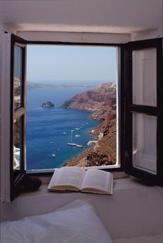 "City of Santorini in Greece. Santorini was formed by a series of volcanic eruptions. The island was once known as Stongili, which means ""round"" in Greek. Beautiful World, Beautiful Places, Amazing Places, Haus Am See, Window View, Open Window, Through The Window, Oh The Places You'll Go, Windows And Doors"