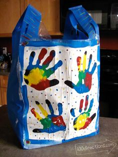 Colorful painted handprint shopping bag