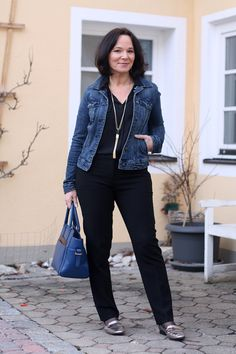 Black jumpsuit and a classic blue denim jacket - style over 50