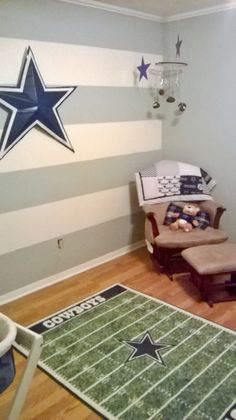 Rugged Wearhouse I made the Cowboy star on the wall out of cardboard from the stroller box The rug is from Nebraska Furniture mart The crib will go below the star