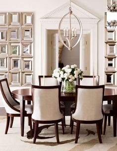 White dining room.  Mirror wall treatment.
