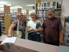 Kelly, Chris and Jim know the Library's a good place to meet old friends!