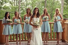 Rustic cabin wedding photo on balcony or porch.   first look site for bride and groom?