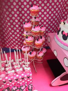 Cake pops and cupcakes at a Minnie Mouse Birthday Party!  See more party planning ideas at CatchMyParty.com!