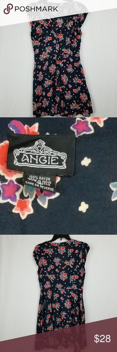 ANGIE BOUTIQUE FLORAL DRESS SIZE SMALL ANGIE BOUTIQUE FLORAL DRESS SIZE SMALL.  IN EXCELLENT GENTLY USED CONDITION.  ALL ITEMS ARE INSPECTED FOR QUALITY.  BUTTON FRONT CLOSURE NAVY WITH FLORAL PRINT PATTERN FABRIC.   SHORT SLEEVES.  V NECK LINE WITH CUT OUT DETAIL AT THE NECK LINE. Angie Dresses Midi