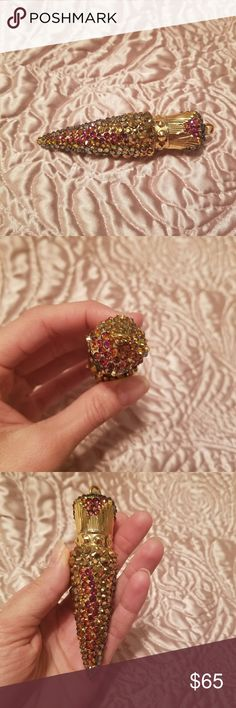 Swarovski volcano lipstick holder/pendant 24k gold and volcano color changing swarovski crystal. Nude color lipstick inside (melted a little from being in the sun) sparkles gold,pinks,purples,coral. Makeup Lipstick