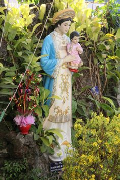 Statue of the Virgin Mary in the Garden of a Catholic Church