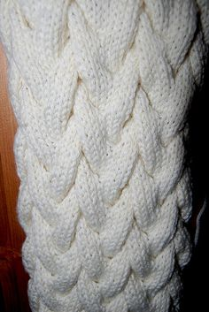 Free Pattern: mamiecaisse's Cabled Scarf. Follow 'About this Pattern' on right for link to Woven Cables Scarf. Pattern easier than it looks.