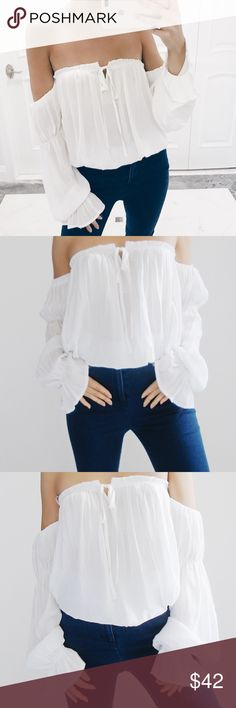 🆕 • Amelia Off The Shoulder Ruffled Top Ruffles open/off the shoulder chiffon top in Ivory with front tie. Sleeves are attached. 100% Polyester. *Modeling size Small* ☑️ NO trades. Price is FIRM unless bundled. ☑️ Sizes Available: Small, Medium, and Large (ONE left). *Jeans also available for purchase* Tops Blouses