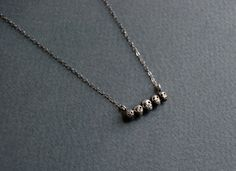 Tiny sterling silver skull necklace by datter on Etsy, $52.00