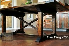 "The San Diego 72 is a modern yet rustic farmhouse dining table finished in dark walnut. The wood has been avec aged with an oxidization solution and distressed to give out that worn look. Dimensions: 72""L x 44""W x 30""H."