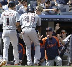 Detroit Tigers manager Jim Leyland greets Torii Hunter (48) at the dugout after Hunter hit a three-run home run during the sixth inning of a baseball game against the New York Yankees on Saturday, Aug. 10, 2013, in New York. (AP Photo/Frank Franklin II)
