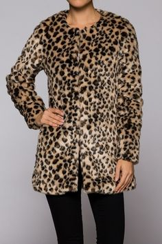 Faux fur jacket. Very soft 60% acrylic 40% polyester Hand wash cold. Do not bleach. Made in China.