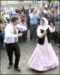 Bride and groom dance at their wedding wearing traditional Talysh costumes in the province of Gilan, Iran.