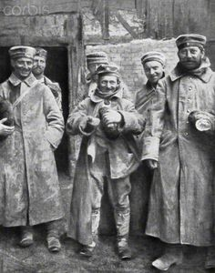 German prisoners of war with their ration of bread, 1915. Artist: Unknown