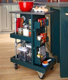 Make a Kitchen Storage Cart ~~~  Designed to fit under a kitchen island, this do-it-yourself cart offers easy mobility and ample storage for kitchen supplies. Have all the kitchen storage you need? This cart works great in other areas of the home, too!