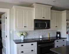 My kitchen:  White cabinets, dark counters, dark drawer pulls